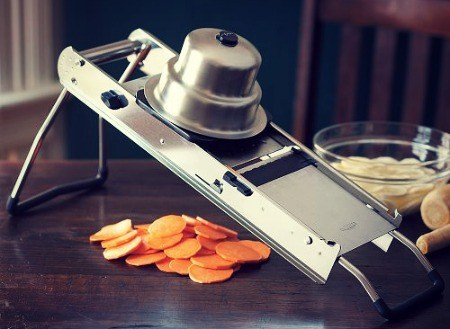 A mandoline slicer comes with a flat, board like base