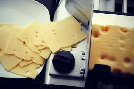Slicing the swiss cheese.